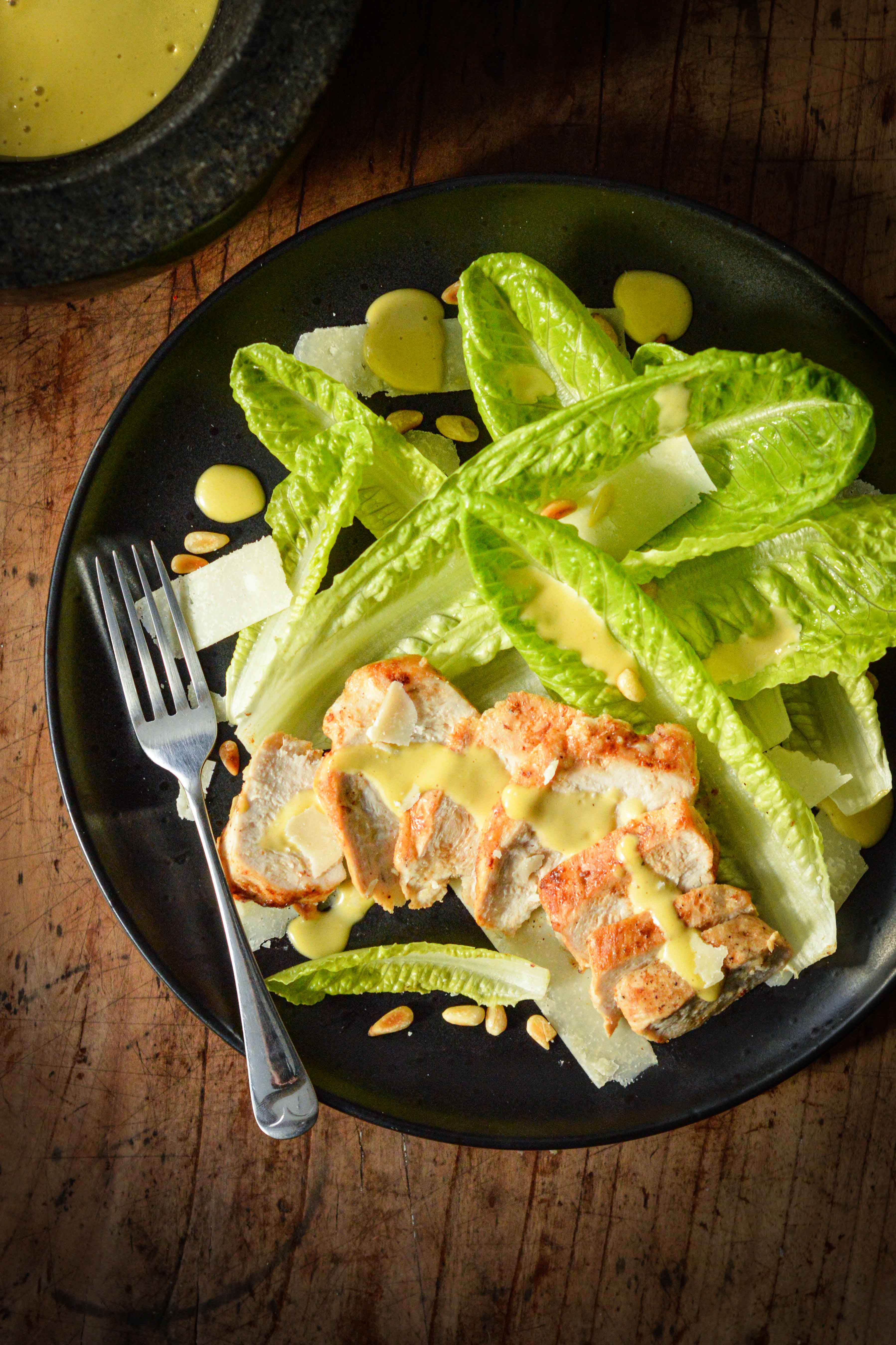 Keto Caesar salad - With a delicious keto Caesar dressing & pine nuts instead of croutons,the Caesar salad carbs are kept low but the flavours are still sublime.