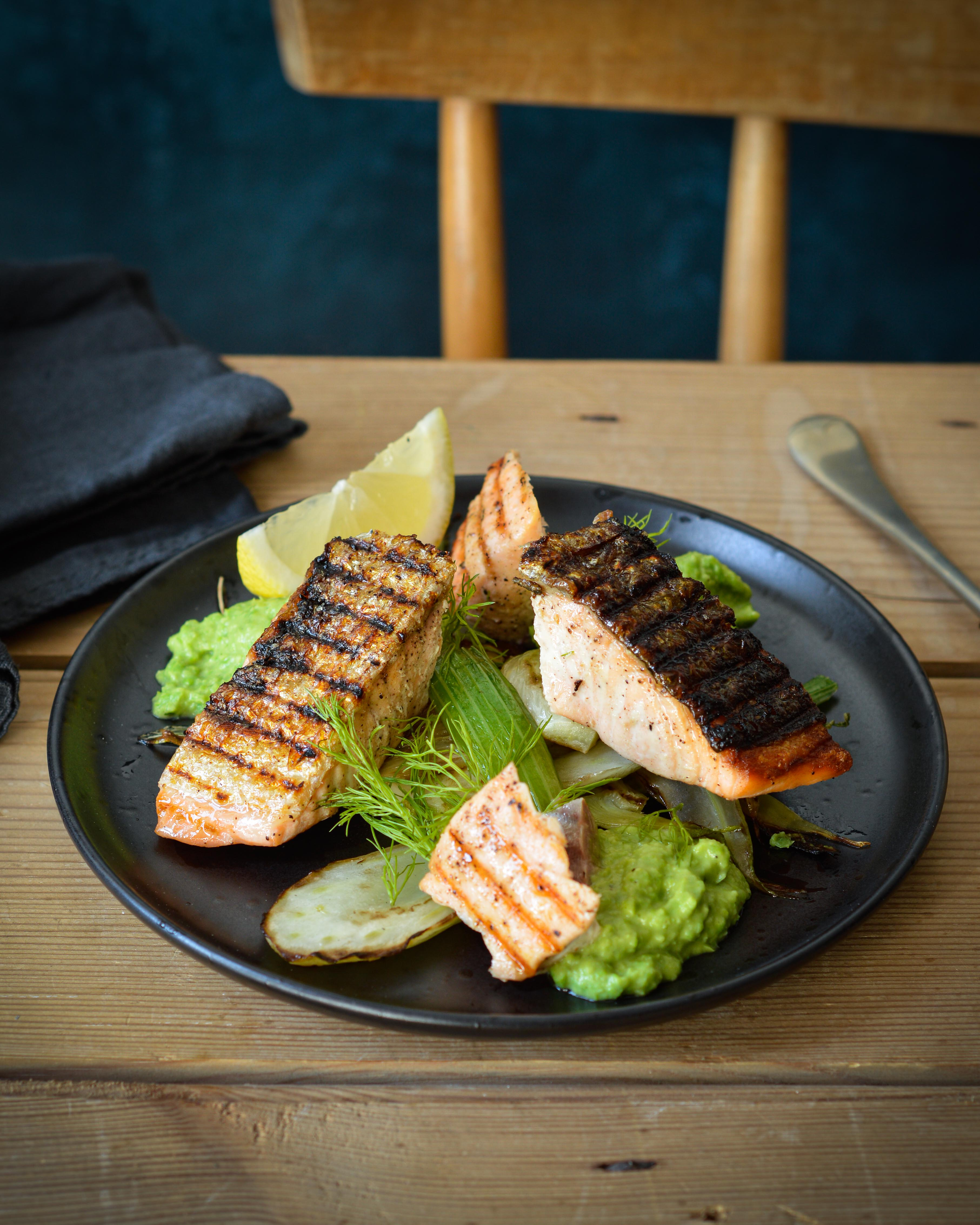 Grilled salmon with pea puree and fennel.