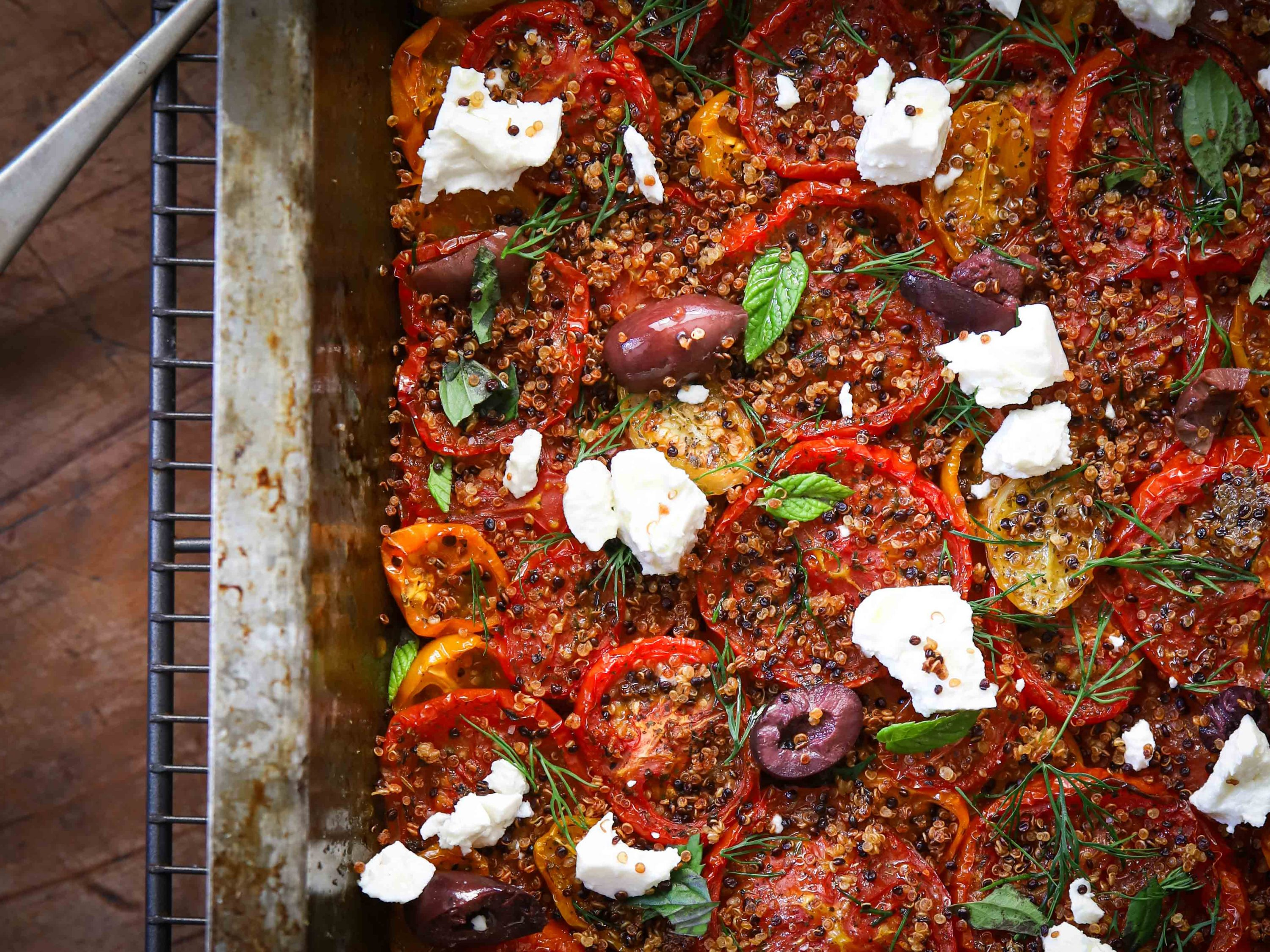 Beautiful roasted vine tomatoes & crispy quinoa, scattered with crumbly feta, torn olives & fresh herbs. An easy, healthy vegetarian lunch.